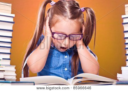 Little scholar girl with pile of books yelling