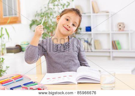 Little kid at home doing homework