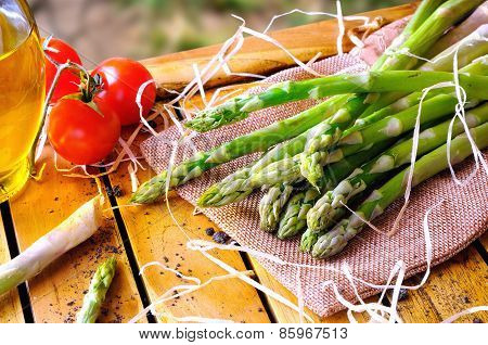 Asparagus With Tomatoes On A Table In The Field