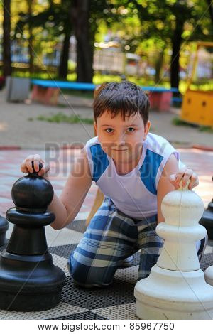 Boy Plays In The Big Chess