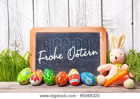 Background for Easter with german text. Decoration with sugar rabbit, eggs and message board
