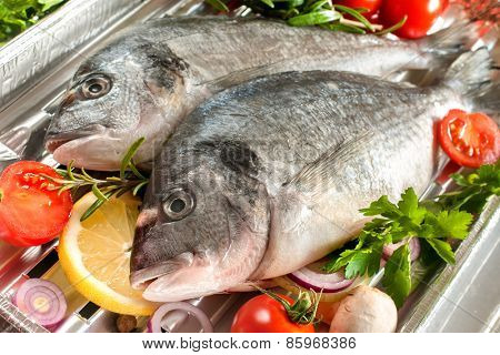 gilt head bream with vegetables on a grill