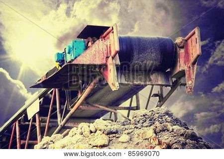 Conveyor on the dramatic , stormy cloudscape