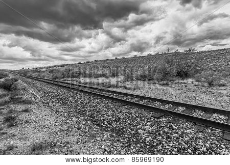 Dramatic Clouds And Empty Rails In Desert