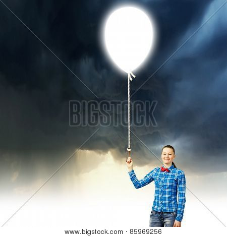 Young woman in casual holding balloon. Idea concept