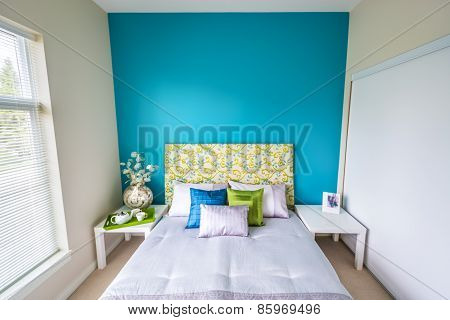 Modern blue bedroom interior.