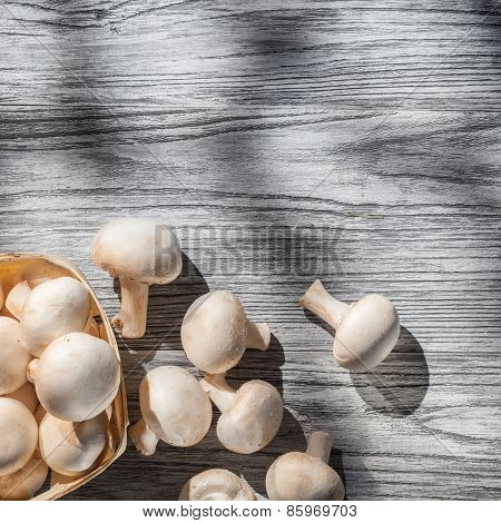 Mushrooms on wooden table, top view image