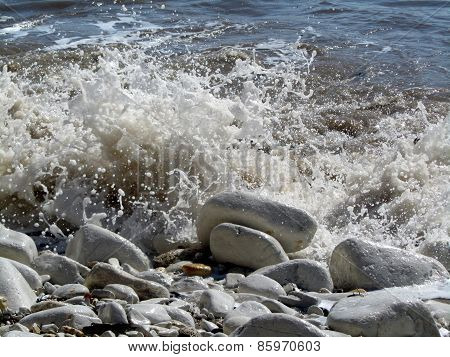 Small waves splashing on to the beach