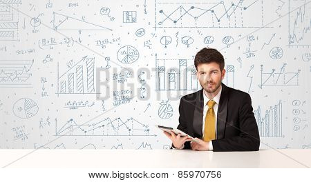 Businessman sitting at white table with hand drawn diagram background
