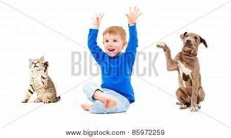 Happy boy, kitten and puppy