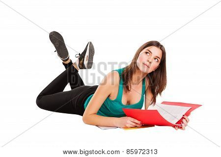 Isolated student lie on the floor with book, dreaming.