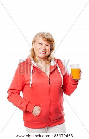 Attractive middleaged woman with a glass of juice