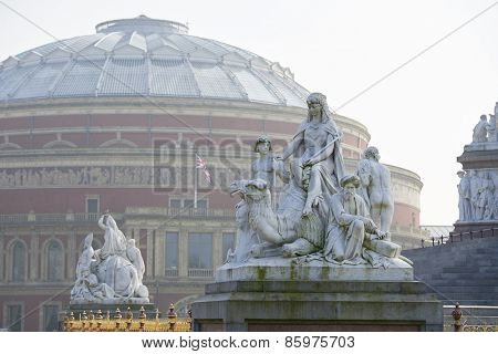 Albert Memorial statue overlooking hazy Royal Albert Hall, in London. The concert hall is home to the Proms, which take place each summer since 1941.