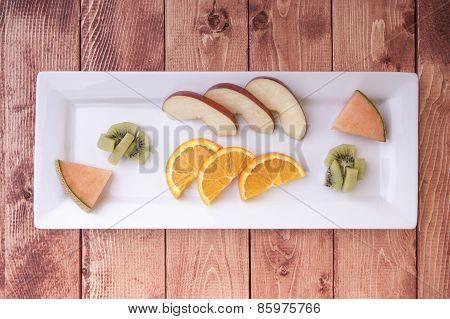 Plate Of Sliced Fruit.