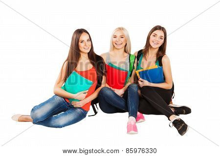 Happy students sitting together with fun, while smiling and looking at camera isolated on white back