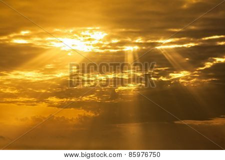 sunset sky with light rays and cloudscape