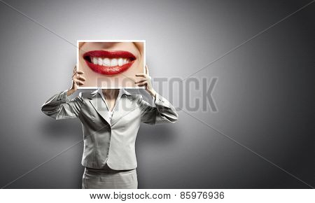 Businesswoman holding banner with macro mouth image
