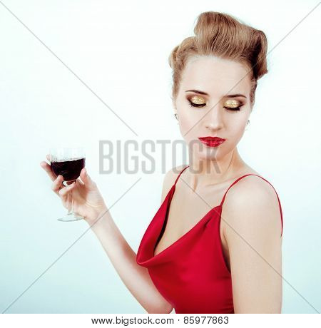 Beautiful Sexy Woman In Red Satin Dress And Red Lips Drinking Vine