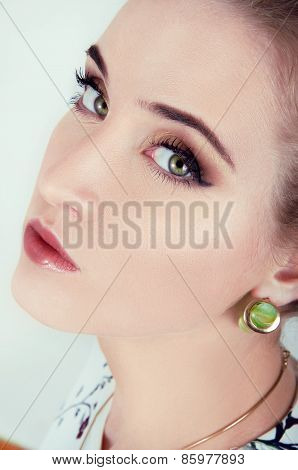 Beautiful Sexy Woman With Natural Day Makeup Wearing Green Earrings