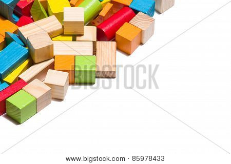 Wooden Blocks Lying In Line Over White Background