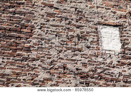 Old grunge brick house wall