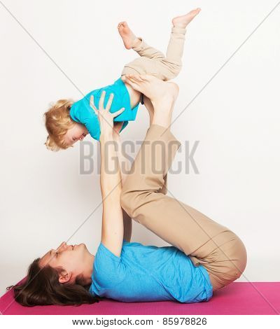 father holding his little son on his feet, yoga, happy family