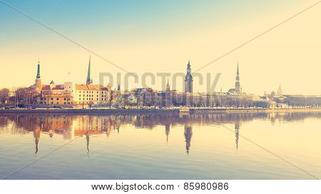 Beautiful scenery of Riga center with reflection in Daugava, with retro filter effect