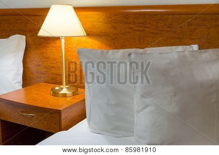 Pillows and lamp in hotel room