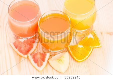 Top View Of Fresh Juice In Glass With Pieces Of Various Fruits.