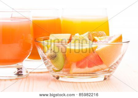 Fresh Fruit Salad In Glass Bowl With Juice