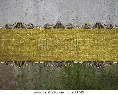 Template For Design. Golden Plate With Ornament On A Background Of A Wall