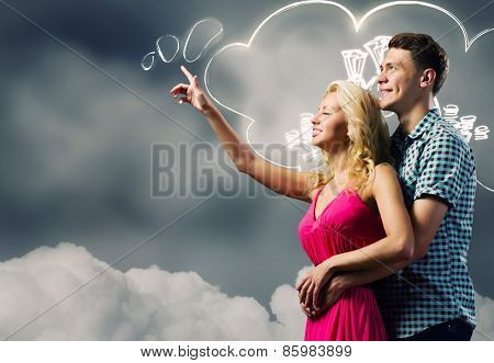 Young happy couple dreaming about future life
