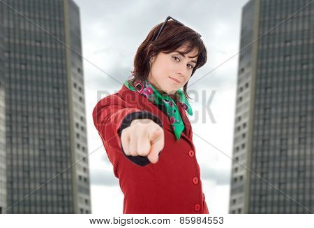 young business woman pointing, at the office