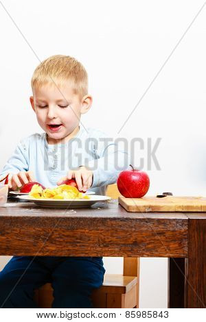 Little Boy Peeling Apple Cooking At Home.