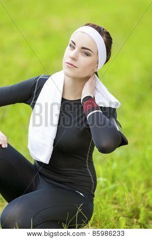 Happy Caucasian Brunette Sportswoman Relaxing Outdoors