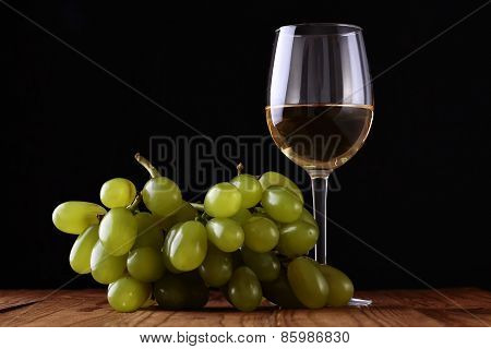 Wineglass And Grape On Wooden Table