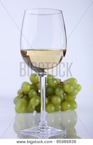 Glass Of Wine And Grape Branch