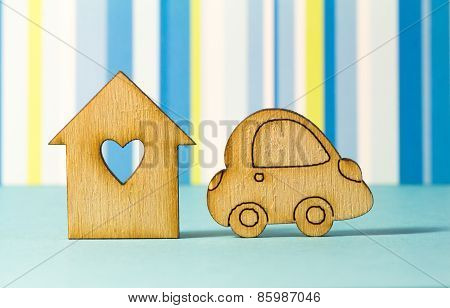 Wooden House With Hole In The Form Of Heart With Car Icon On Blue Striped Background