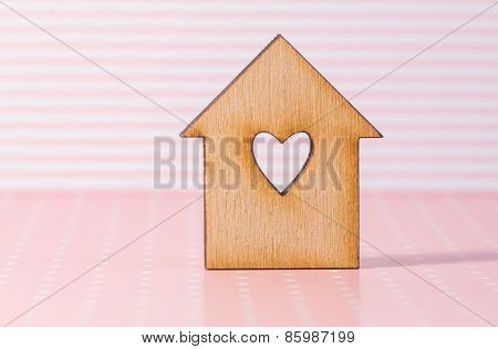 Wooden House With Hole In The Form Of Heart On Pink Striped Background