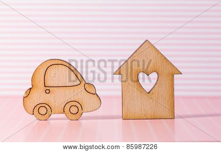Wooden House With Hole In The Form Of Heart With Car Icon On Pink Striped Background