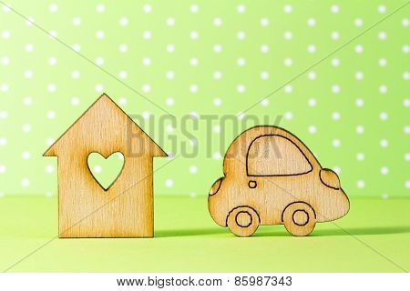 Wooden House With Hole In The Form Of Heart With Car Icon On Green Background