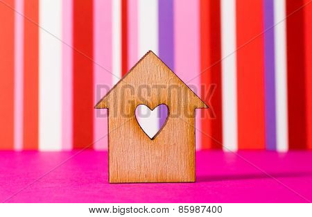 Wooden House With Hole In The Form Of Heart On Red Striped Background