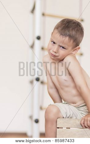 Portrait Of Caucasian Little Boy Grimacing Indoors