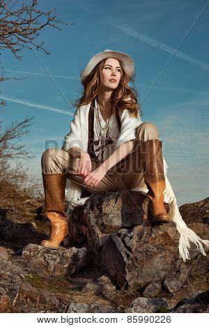 Fashion photo of model woman in mountain