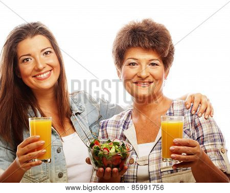 two women with juice and salad