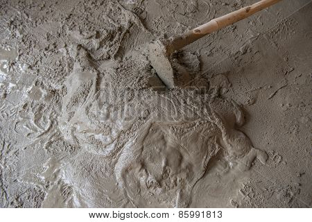 Worker Is  Mixing Mortar