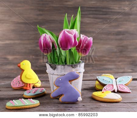Delicious Easter cookies on table on wooden background