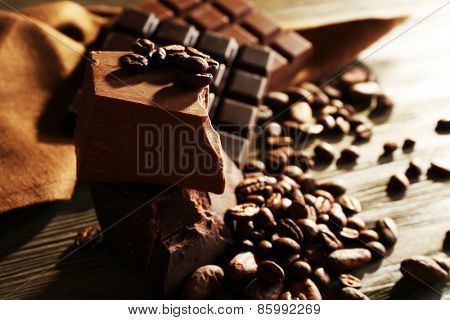 Still life with set of chocolate with coffee grains, closeup