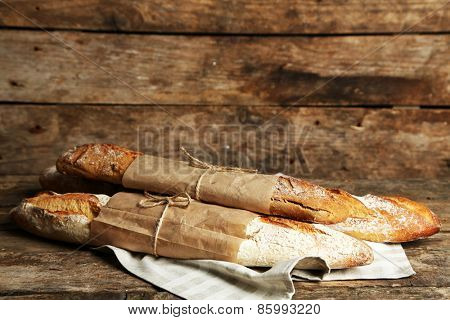 Fresh bread on old wooden table