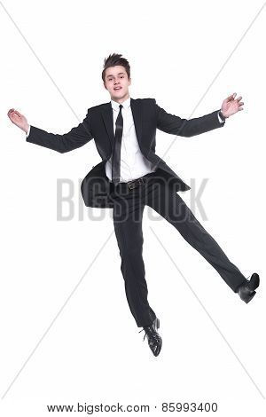 Young business man flying isolated on white back ground